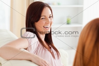 Charming women relaxing on a sofa