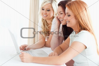 Charming Women sitting at a table with a laptop