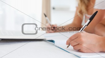 Close up of Students sitting at a table doing their homework