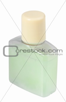 Green cosmetic cream in transparent bottle