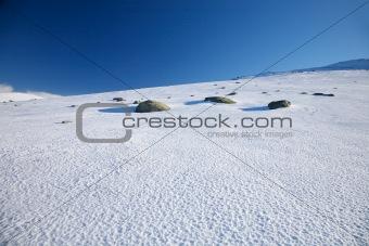 three rocks on snow