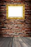 golden frame on old brick wall