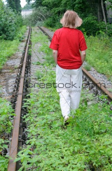 Walking Away Down Uncared Railroad Track