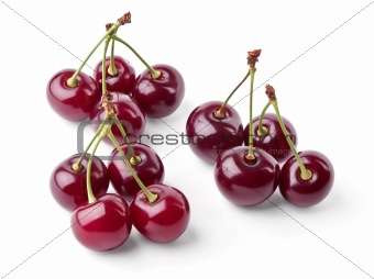 Three groups of juicy cherries view from top