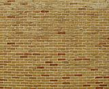 yellow orange red colored bricks in a large wall