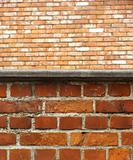 close view of a brick wall with another brick wall in the distan
