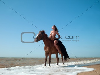 nude woman on horseback