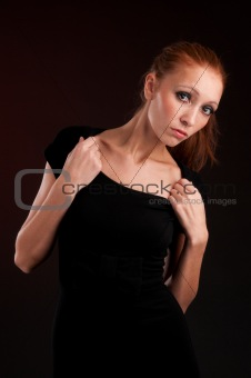 young redhead woman in black dress