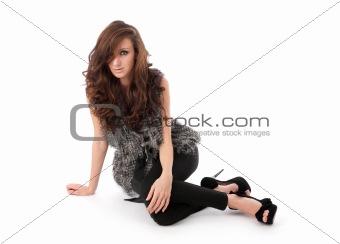 Beautiful young woman sitting.