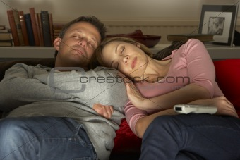 Couple Asleep In Front Of Television