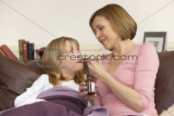 Mother Giving Medicine To Sick Daughter