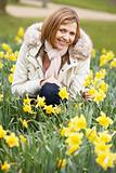 Woman Kneeling In Daffodils
