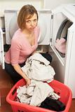Unhappy Woman Doing Laundry