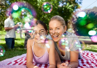 Mother and daughter having fun in the park
