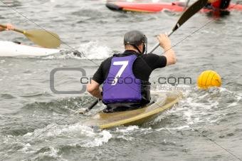 Man is playing kayak polo