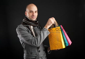 Young men with paper presents bags
