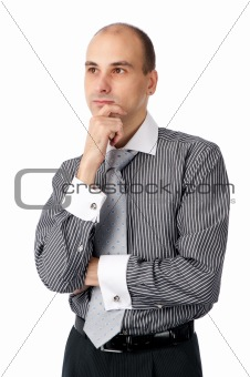 Portrait of handsome young business man looking away