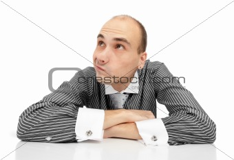 Portrait of handsome young thoughtful businessman isolated over
