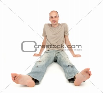 relaxed man sitting on the floor