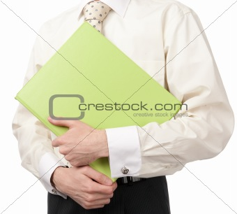 businessman holding green folder