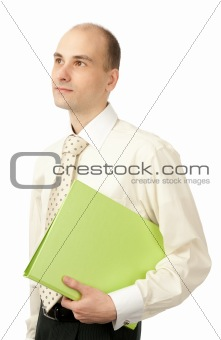 Portrait of young businessman with folder