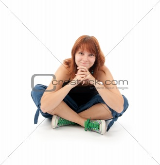 Happy young female sitting relaxed on the floor