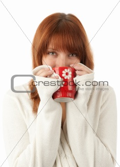 smiling young female drinking a cup of coffee