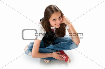 Teenage girl sitting on the floor