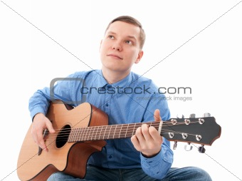 Young Male Guitarist with his acoustic guitar