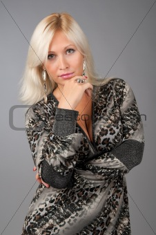 Blonde business woman thinking