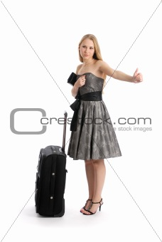 Beautiful young woman hitch hiking with suitcase