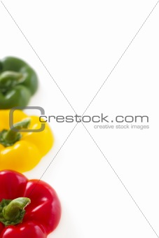 Three colorful bell pepper tops with copy space, isolated