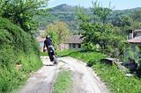 Riding Motorbike Down Country Road