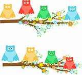 family owls sitting in branches on tree with flower