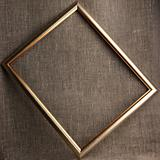 Bronze frame on grunge textile background
