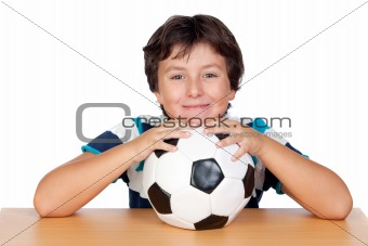 Adorable boy with a soccer ball