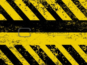 A grungy and worn hazard stripes
