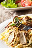 pasta with cap mushrooms on a plate