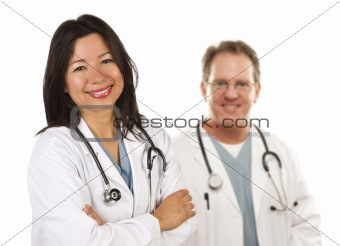Friendly Hispanic Female Doctor and Male Colleague Behind Isolated on a White Background.