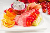 mixed plate of fresh sliced fruits