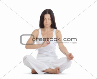 woman sitting on the floor exercising yoga - isolated on white