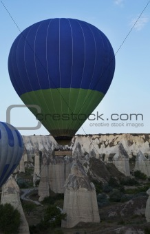 Green Blue hot air balloon low level flight