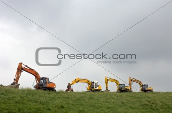 Four diggers on a dyke
