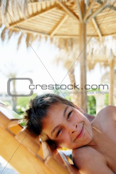 Smiling boy portrait on beach