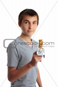Boy holding a nutritional snack bar
