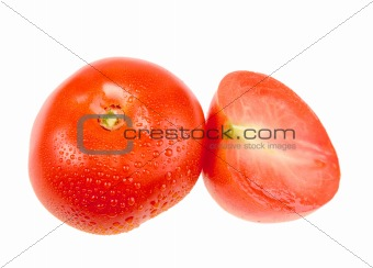 Cross and full ripe red tomatoes with dew