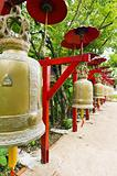 Row of bells in a temple covered by red umbrella