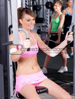Portrait of young female exercising