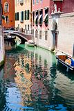 canal, boats and bridge in Venice