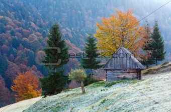 autumn mountain view with shed